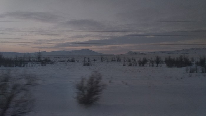 Карагандинская область из окна поезда Фотограф, Казахстан, Карагандинская область, Закат, Зима, Горы